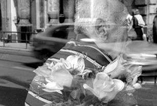 An old man behind a shop window in Sarajevo, Bosnia.