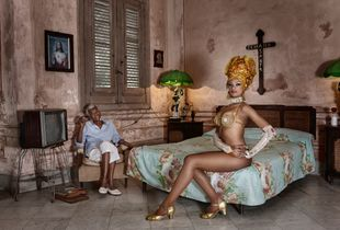 Joana Gonzalez sitting with her grandmother, Havana, 2017