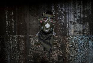 A stalker dons a mock gas mask