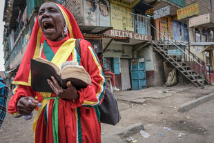 Screaming the Bible. Mathare Kenya, a preacher works at the top of her lungs. © Simone Raso. Chosen for the LensCulture Street Photography Awards Top 100.
