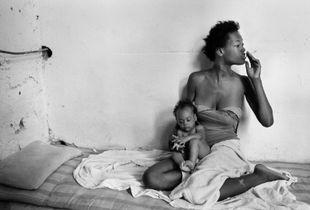 Smoking mother and a child. Havana, Cuba.