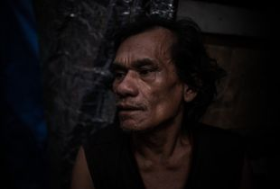 Into The Dark: Scenes From South East Asia's Meth Epidemic. An addict in his home in a slum, Manila, Philippines.