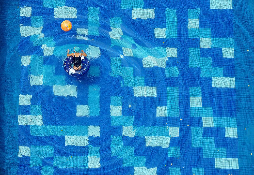 "Geometry of Swimming. From the series ""Geometry and Color"" © Jolanta Mazur. Finalist, LensCulture Street Photography Awards 2017."