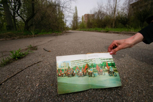 """Pripyat, Ukraine 2005. A photo of the same street years earlier. """"Radiation: it scares people and it scares animals. And birds. And the trees are scared, too, but they're quiet."""" —Anna Badaeva"""