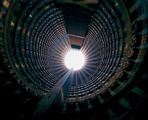 Ponte Tower,  a 52-floor circular structure, is the biggest residential building in the southern hemisphere.  20 years ago, Ponte was the place to live in downtown Johannesburg. The penthouses had mirrored bars and shag pile carpeting. Then Ponte lost its allure, becoming a no-go area during the 1990s overrun by Nigerian gangs, crack dens and prostitution. Now it has mostly immigrant residents.