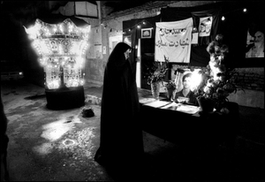A mother weeps for her son who died during the war with Iraq. Thousand of young boys were killed during this 8 year old war. Tehran, IRAN - April 1981 © Copyright 1979-2009 Alfred Yaghobzadeh. All rights reserved.