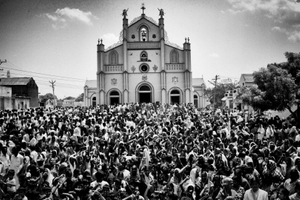 Villagers from the Koothankuli, prevented from going to Idinthakarai by the imposition of a curfew, gather in front of the church and shout anti-government slogans.