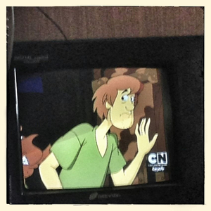 "Close up detail of a television playing cartoon ""Scooby Doo""in the family home of Rahma*"