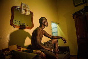 Dakar, July 23, 2016. Kherou Ngor takes a rest at his room after his successful fight on July 22.