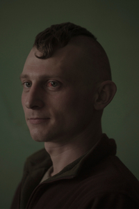 Petro, 27, builder, picture was taken after he spent 9 months in the war zone, March 2015, Ukraine.