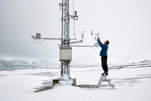 Senior engineer of the Arctic base, preparing tools for measuring different climate data