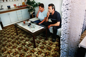 Daniela and Ladislav: unemployed couple smoking in a rented one-room flat, Pezinok, 2004. © Andrej Balco