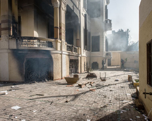 In the courtyard of a school assaulted on Joussef El-Gendy, two boys are fighting against the police. For two days and nights the Army fought the protesters. Both schools were partially burned. © Domenico D'Alessandro