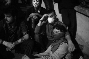 "The siege took its toll on both sides. A group of protestors trying to get some rest during the confrontations in the Gumussuyu area. From the series ""Witnessing Gezi"" © Emin Ozmen"