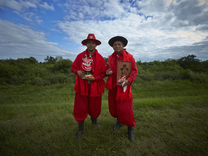 Gauchito Gil devotees gathering in Mercedes town for the celebrations of January 8, date of the murder of the popular saint, dressed up in the typical red colour costumes