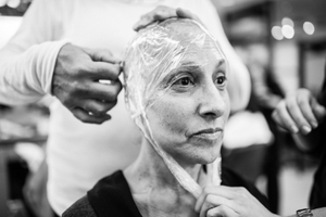 At the Rodolfo Valentin Salon in Manhattan, Laurel Borowick gets fitted for a new wig, as she gave away most of her older wigs from previous cancer diagnosis. New York City, New York. February, 2013 © Nancy Borowick