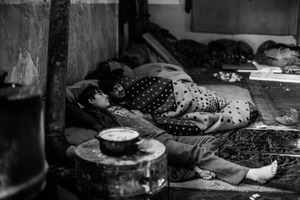 15 years old Shaw Khan from Afghanistan ( at the front) with his friend in abandoned warehouse in Belgrade, Serbia.