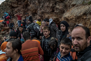 Refugees and migrants just landed on the Greek Island of Lesbos after crossing the Aegean sea from Turkey on October 11, 2015.