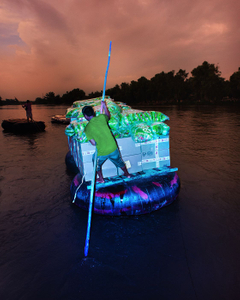Transfer of goods illegally on the Rio Suchiate with a artisanal inflatable tube boat,Mexican border, Tecun Uman, Guatemala, 2016