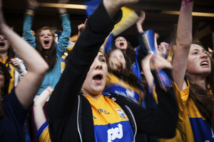 Clare supporters celebrating a goal against Cork in All Ireland Final.