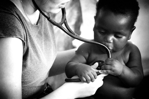 A volunteer Brazilian doctor attending a Mozambican child. Only about 30% of children receive exclusive breastfeeding up to six months of age.
