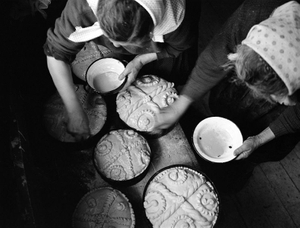 Easter Bread, Sirbi, 2000. Easter marks the changing of everything. Spring demonstrates the earths resurrection in imitation of their Lords. For women, it is an annual opportunity to show their artistic flair as they rival the gate carver with decorated bread. © Kathleen Laraia McLaughlin.