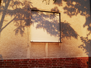 """Window of a house along the """"Death March"""" route from Sachsenhausen concentration camp."""