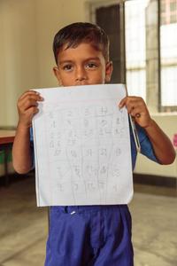 Boy holding class work
