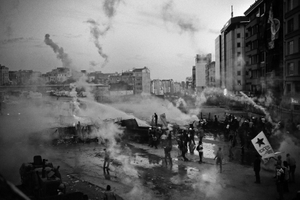 "Police forces continued using large quantities of tear gas to try and break up the protests that had lasted for many days. From the series ""Witnessing Gezi"" © Emin Ozmen"