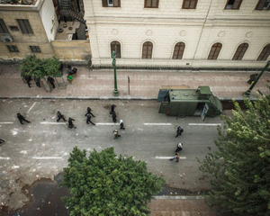 "Soldiers on el Shaikh Rihan, in the ""red zone"" protected by wall and police, the day after the clashes near the école française on January 26. The Police control protesters from the top of the roofs of the buildings with stone throwing and tear gas.   © Domenico D'Alessandro"