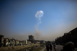 A suicide car bomb exploded near the main gate of the NATO-led international military mission in Kabul Saturday, killing three Afghans and wounding 70, officials said. The Taliban claimed responsibility. This is smoke from the car bomb, scene from beside the Kabul river. © Michael Christopher Brown