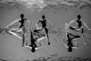 Members of the Neptun Synchro synchronized swimming team perform during a Christmas show in Stockholm, Sweden, on 13 December 2015.