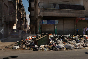 Aleppo: Piles of garbage lie in mounds on every street. Residents unsuccessfully try to burn these bags and the stinking piles grow by the day.