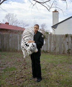 "Sharrod and the white tiger. From the series ""I slowly watched him disappear"" © Jason Hanasik"