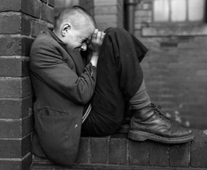 © Chris Killip Youth on Wall, Jarrow, Tyneside, 1976. Courtesy of the artist and The Photographers' Gallery, London