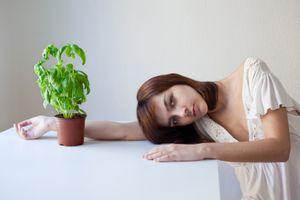 Isabella and her basil plant ©  Sandra Mirey