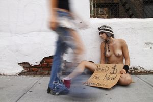 Begging on Houston. From the series, Nue York: Self-Portraits of a Bare Urban Citizen, © Erica Simone