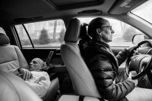 The drive to chemotherapy treatment takes half an hour, and Howie and Laurel Borowick take turns, resting and driving, depending on whose getting treatment that day. Greenwich, Connecticut. January, 2013 © Nancy Borowick