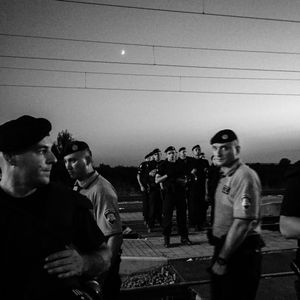 Croatian police guard the tracks as hundreds of refugees wait for trains in Tovarnik.