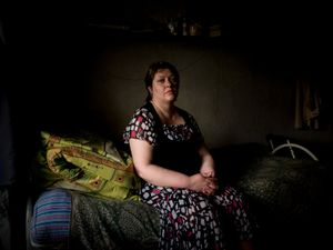 A political refugee in her bedroom in one of Donetsk's dormitories. After being arrested by the Ukrainian security service in Mariupol she moved to Donetsk where she's being hosted for more than two years.