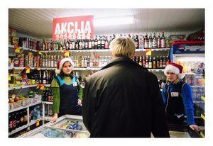 Kestas walks into the shop, decorated for Christmas, December 2002 © Mindaugus Kavaliauskas