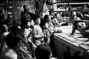 Spectators during a boxing match. © Sandra Hoyn