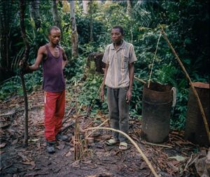 RM Major Bamwizio Kilumbalumba Wamenya and his neighbor build traps in the surrounding jungles for catching small animals. RM say they receive no pay for their service, so their survival often depends on working in the mining industry or trapping wild animals. © Diana Zeyneb Alhindawi
