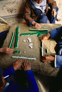 Men playing mahjong, Yunnan, China, 1992.