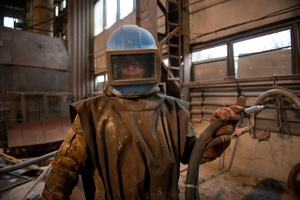 Yuriy wearing the protective suits to sandblast the radioactive scrap metals. Chernobyl Exclusion zone