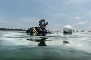 UXO salvage diver Piseth Dara (24) prepares to dive. Dara is taking part in a training programme devised by the USA 7th Engineer Dive Detachment off the coast of Sihanoukville, Cambodia.