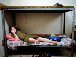 "Inbar talking to family during a break from basic training, Shaare Avraham, Israel, 2004. From the series ""Serial No. 3817131"" © Rachel Papo"