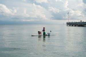 Marcie The Paddleboarder and Mimi The Dog, Casa Marina, Key West, Florida. © Rona Chang