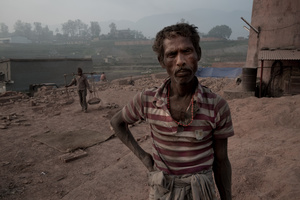 Brick Factory worker, standing