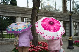 Women with umbrellas near Blue Mosque, Istanbul